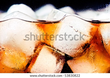 Glass of cola with ice cubes closeup - stock photo