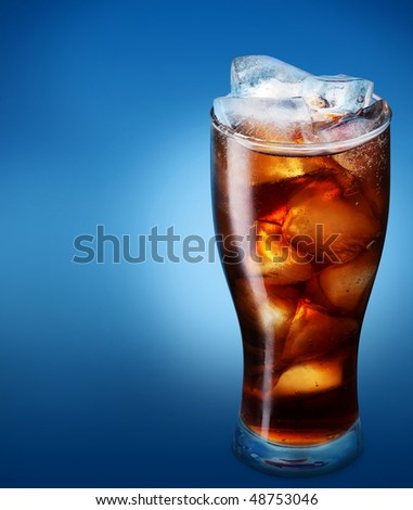 Glass of cola with ice on a blue background - stock photo
