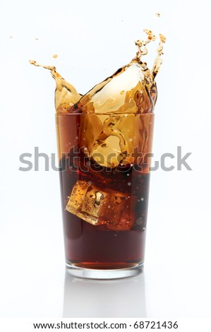 Glass of cola with splash - stock photo