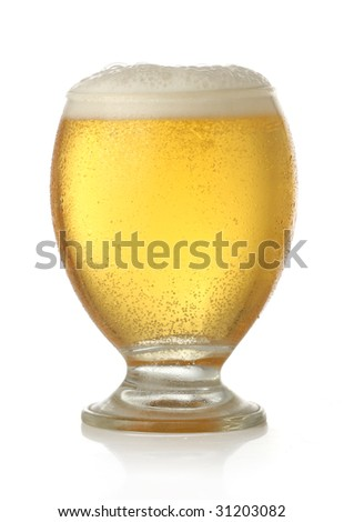 Glass of cold and fresh golden beer, over white background