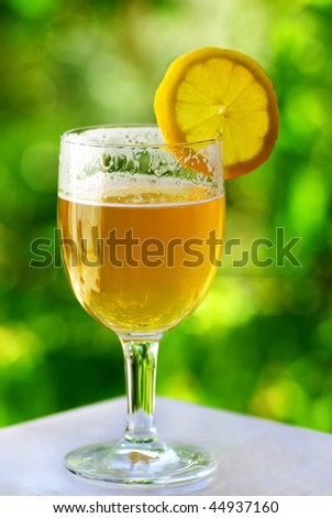 Glass of cold beer and lemon. - stock photo