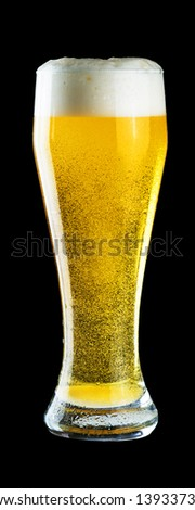 Glass of cold beer on black background - stock photo