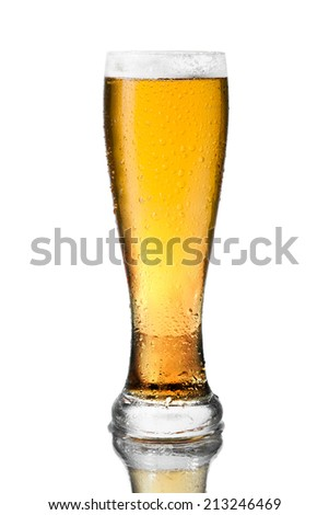 glass of cold beer with drops on white background - stock photo