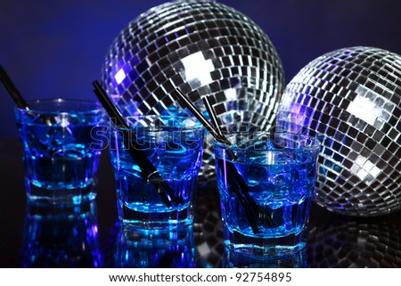 Glass of cold blue cocktail - stock photo
