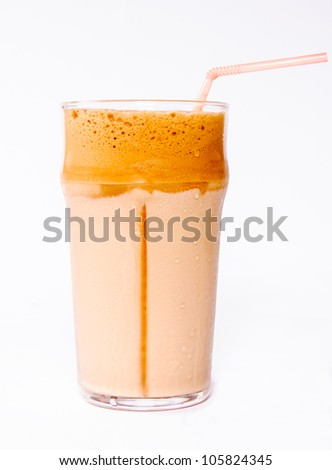 Glass of cold coffee in the glass