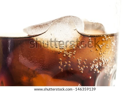 glass of cold cola with ice cubes - stock photo