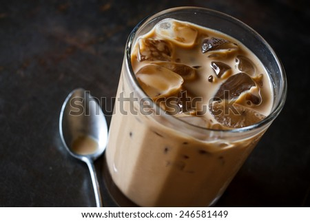 Glass Of Cold Iced Coffee On grunge tray, image dark tone - stock photo
