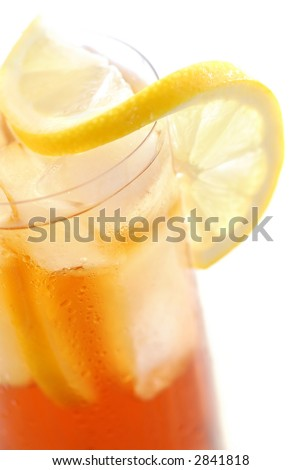 Glass of cold lemon iced tea with ice, lemon and water drops on glass surface - stock photo