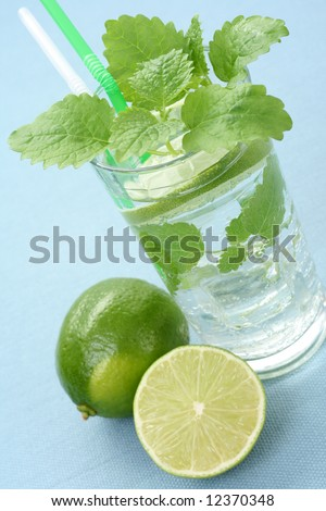 glass of cold mojito on blue backgrund