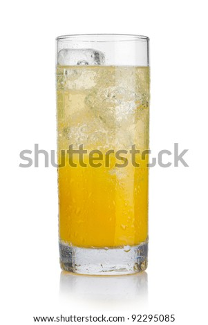 Glass of cold orange beverage with ice - stock photo