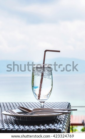 Glass of cold water on dining table on the island