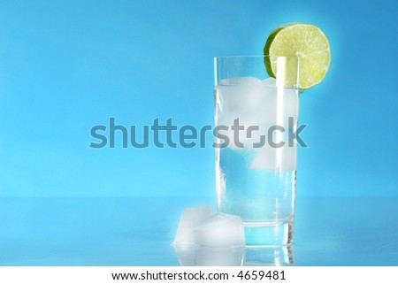 Glass of cold water with ice cubes - stock photo