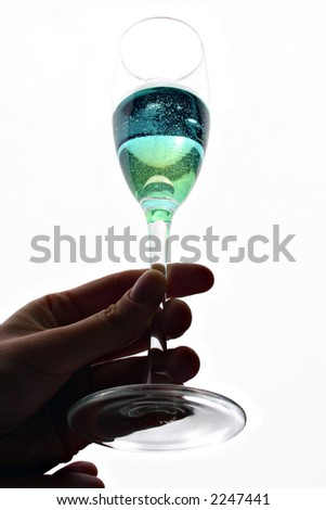 Glass of coloured champagne in woman's hand
