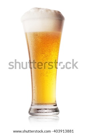 Glass of cool light beer isolated on white background