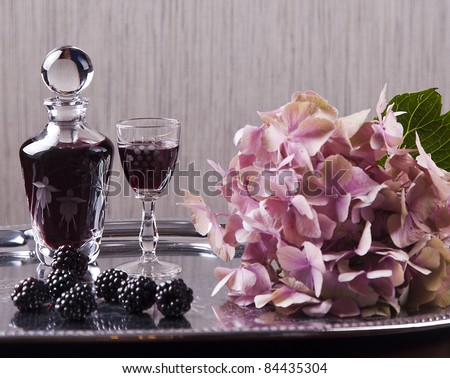 glass of cordial and hydrangea - stock photo