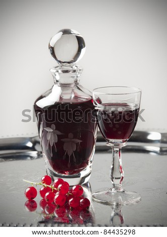 glass of cordial on silver background - stock photo