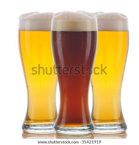 Glass of Dark Ale Beer with Foamy Head in front of two Pale ales with Reflections isolated on white. Square Composition.