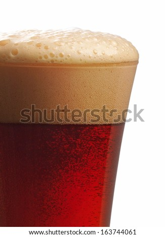 glass of dark beer closeup on white background - stock photo