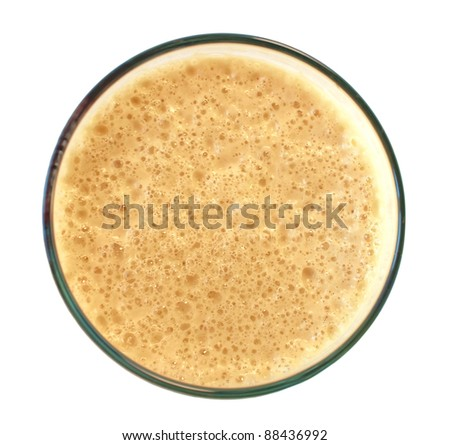 glass of dark stout beer with foam isolated on white background, top view - stock photo