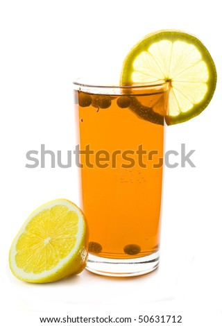 glass of drink with lemon