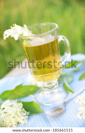 glass of elderberry tea - stock photo