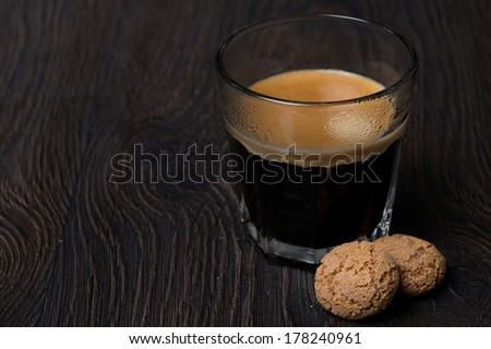 glass of espresso and almond cookies, close-up, horizontal - stock photo