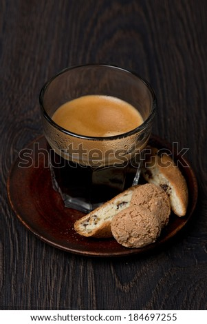 glass of espresso, biscotti and almond cookies, selective focus, vertical - stock photo