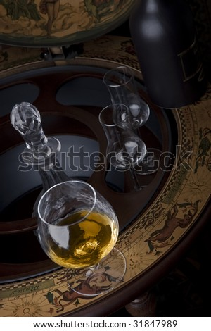 Glass of expenxive alcohol on a luxury table