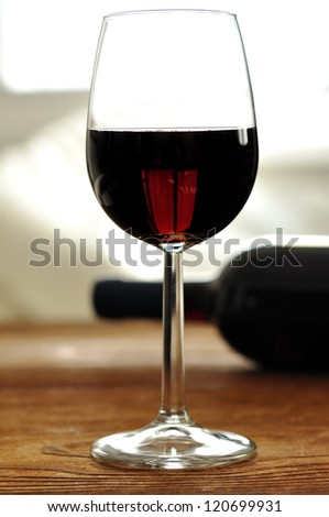Glass of fine italian red wine, selective focus - stock photo