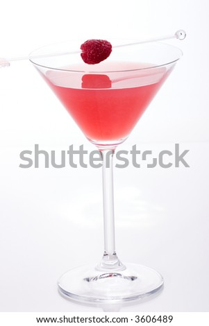 Glass of French Horn cocktail - raspberry liquor, vodka and lemon juice - garnished with whole raspberry - stock photo