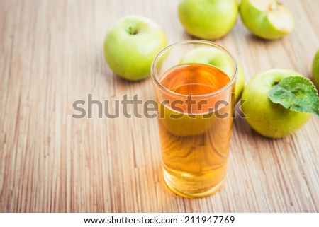 glass of fresh apple juice - stock photo