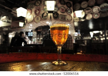 Glass of fresh beer  Delirium bar Brussels - stock photo