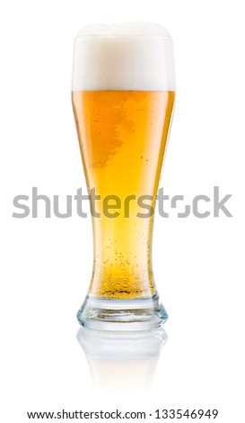 Glass of fresh beer with cap of foam isolated on a white background - stock photo