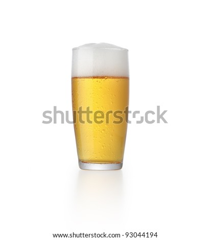 glass of fresh beer with foam isolated on white background - stock photo
