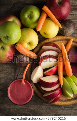 Glass of fresh beetroot, apple and carrot juice - stock photo