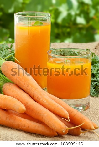 Glass of fresh carrot juice � healthy drink. - stock photo
