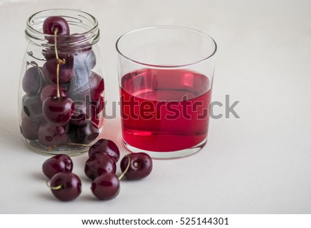 glass of fresh cherry juice and fresh cherries