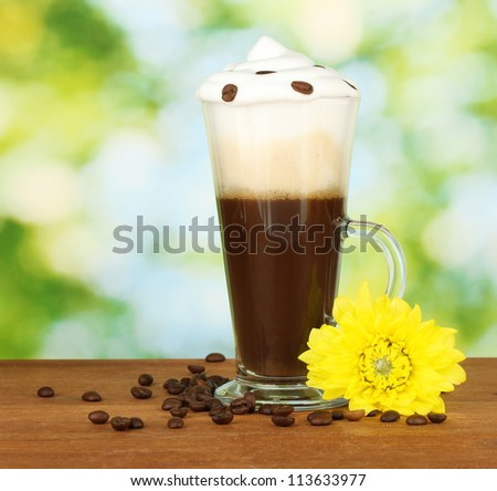 glass of fresh coffee cocktail on green background
