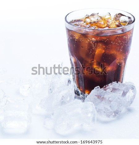 Glass of fresh coke with ice - stock photo