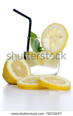 Glass of fresh cool drink with lime fruits isolated on white background.