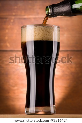 glass of fresh dark beer - stock photo
