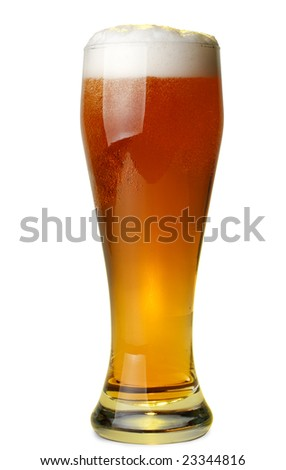Glass of fresh foamy beer on a yellow background