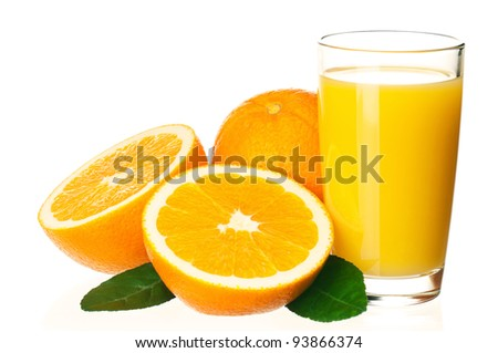 Glass of fresh orange juice and orange fruits with green leaves on white background