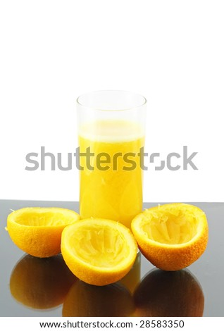 Glass of fresh  orange juice with squeeze slice on gray-white  background.