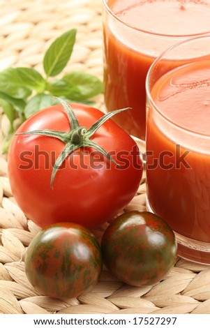 glass of fresh tomato juice and some fresh tomatoes