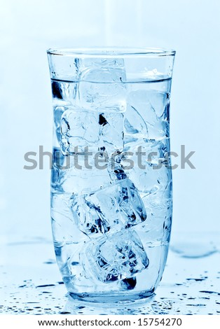 Glass of fresh water with ice cubes - stock photo
