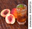 Glass of fruity ice tea perfect for hot summer - stock photo