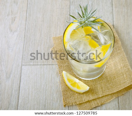 Glass of gin and tonic with ice and lemon. Cocktail with gin and tonic