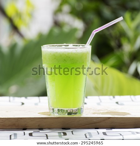 Glass of Green Apple smoothie on the table