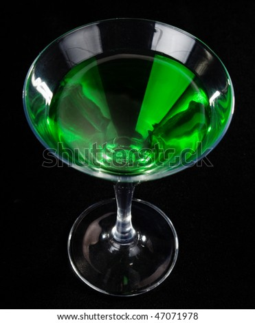 glass of green cocktails on black background - stock photo